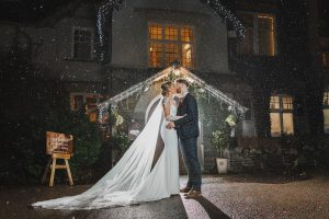 beautiful wedding rain shot in the lake district